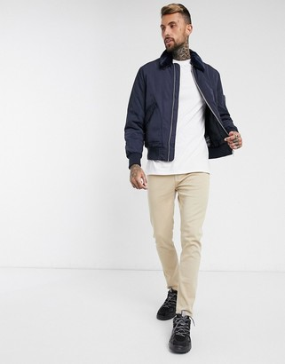 ASOS DESIGN bomber jacket with detachable faux fur collar in navy