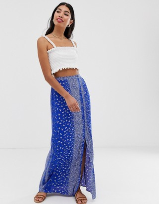 Asos Design DESIGN crinkle maxi skirt with self covered buttons in blue floral print