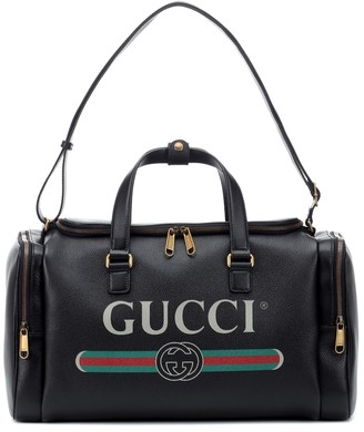Gucci Print leather travel bag
