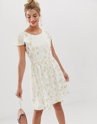 Yumi frill sleeve skater dress in metallic birdcage print-White