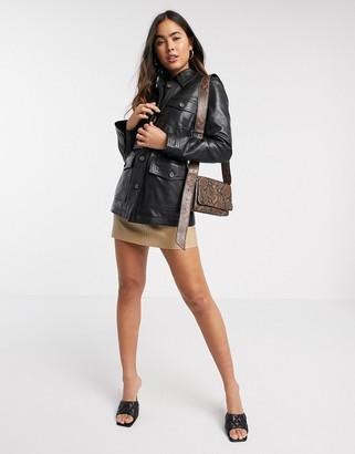 Stradivarius leather belted jacket in black