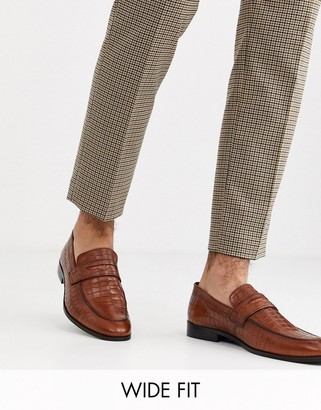 Dune wide fit leather faux croc penny loafer in tan