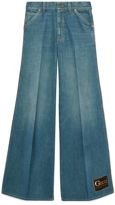 Gucci Stonewashed denim flare trousers