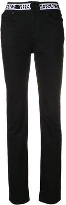 Versus logo waistband jeans