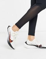 Nike Running Zoom Gravity sneakers in white