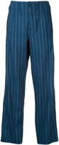 Closed vertical stripe flared trousers - women - Cotton - 25