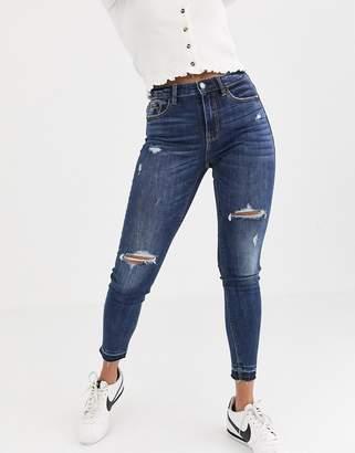 Stradivarius high waist skinny jeans with rips-Blue