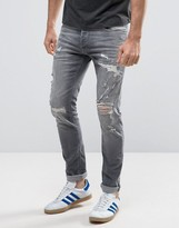 Jack and Jones Intelligence Jeans in Slim Fit with Distress Rips