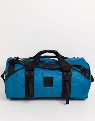 The North Face 94 Rage Explore X-Duffel bag in blue coral/black