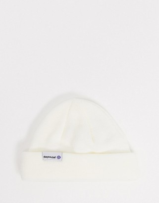 ASOS DESIGN mini fisherman beanie in cream with double turn up and branded patch