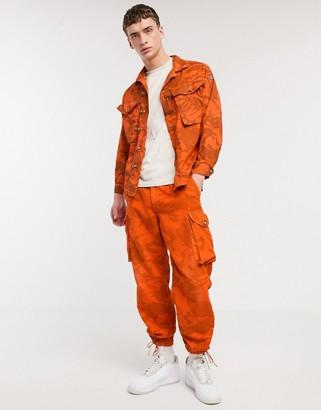 Milk It Vintage camo cargo pant in orange