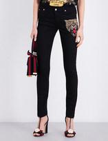 Gucci Tiger-embellished skinny mid-rise jeans