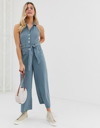 Asos Design DESIGN denim halterneck blazer jumpsuit with belt in washed blue