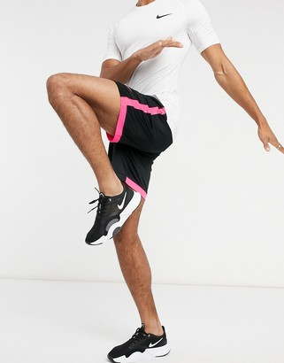 Nike Football academy shorts in black/pink
