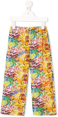 Touriste Graffiti Print Trousers
