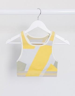 Nike Training Icon Clash seamless bra in yellow print