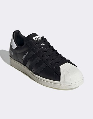 adidas Sigseries Superstar sneakers in white and black