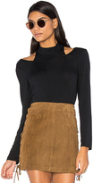Krisa Cutout Turtleneck Top in Black. - size S (also in XS)