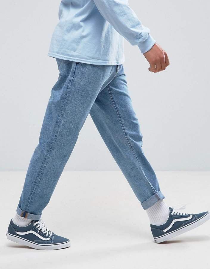 Asos DESIGN double pleated jeans in mid wash blue