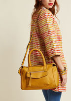 13295 You know a need-right-now bag when you see it - and this mustard purse is pleased to fit the description! Upon spying the envelope-style front pocket, spacious interior, and optional strap of this vegan faux-leather satchel, you'll feel that must-have rus