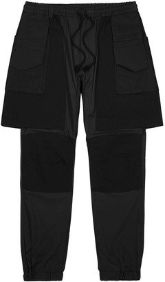 White Mountaineering Black layered shell trousers