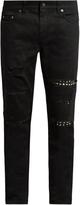 Saint Laurent Distressed stud-trimmed skinny jeans
