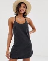Asos Design DESIGN denim sundress with tie back in washed black