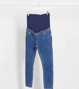 ASOS DESIGN Maternity Petite high rise ridley 'skinny' jeans in bright midwash blue with over bump waistband