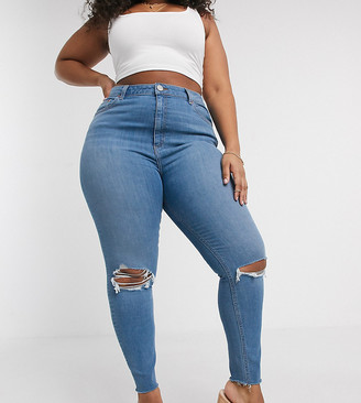 ASOS DESIGN Curve high rise ridley 'skinny' jeans in vintage lightwash blue with slash knee rips and raw hem