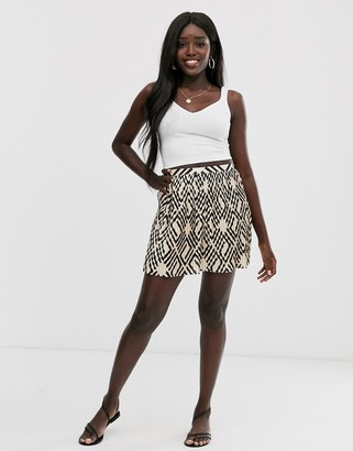 ASOS DESIGN geo print mini pleated skirt