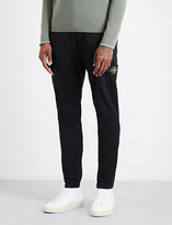 Stone Island Tapered regular-fit mid-rise cotton trousers