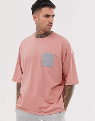 Asos Design DESIGN organic oversized t-shirt with contrast pocket in pink