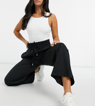 ASOS DESIGN Petite straight leg jogger with deep waistband and pintuck in organic black