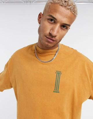 ASOS DESIGN oversized heavyweight t-shirt with small chest historic print in yellow acid wash