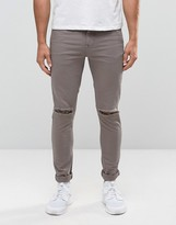 Asos Super Skinny Jeans With Knee Rips In Gray