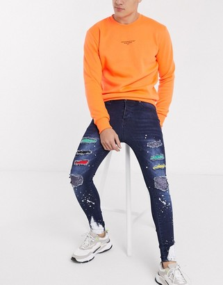 Good For Nothing skinny jeans in dark blue with patchwork and paintsplats
