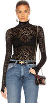 Enza Costa Lace Back Zip Long Sleeve Turtleneck Top in Black | FWRD