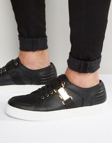 Asos Sneakers In Black With Gold Clasp