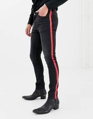 Asos Design DESIGN super skinny jeans in washed black with red vinyl side stripe