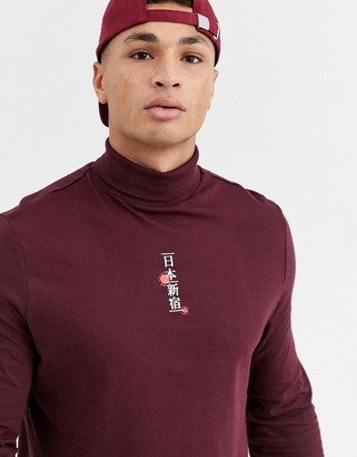 Asos Design DESIGN organic cotton long sleeve t-shirt with Japanese text chest print and roll neck-Purple