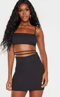 PrettyLittleThing Black Ribbed Strappy Cut Out Detail Bodycon Dress