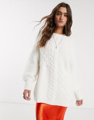 Bershka longline cable knit jumper in ecru