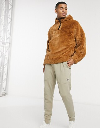 ASOS DESIGN oversized faux fur hoodie in brown with binding & high neck
