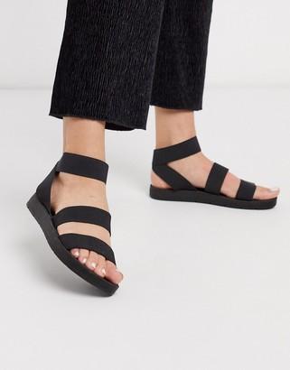 London Rebel elastic strap flat sandals in black