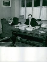 PickYourImage Vintage photo of Pierre Mendes France discussing with a woman on his desk.