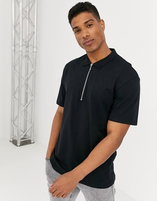 Jack and Jones relaxed fit zip neck polo in black