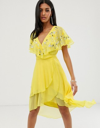 Asos Design DESIGN midi dress with cape back and dipped hem in embellishment-Yellow