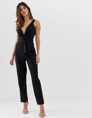 ASOS DESIGN wrap front jumpsuit with peg leg and knot detail