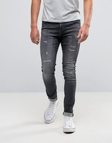 Jack and Jones Intelligence SkInny Fit Jeans In Washed Gray With Rip Repair Detail