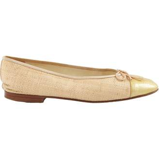 Chanel Gold Leather Flats